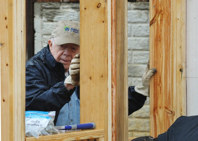 Jimmy Carter helps build a wall during a Habitat for Humanity project on Oct. 4, 2010, in Washington.