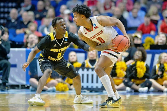 Texas Tech Red Raiders guard Kyler Edwards (0) holds the ball while defended by Northern Kentucky Norse guard Zaynah Robinson (5).