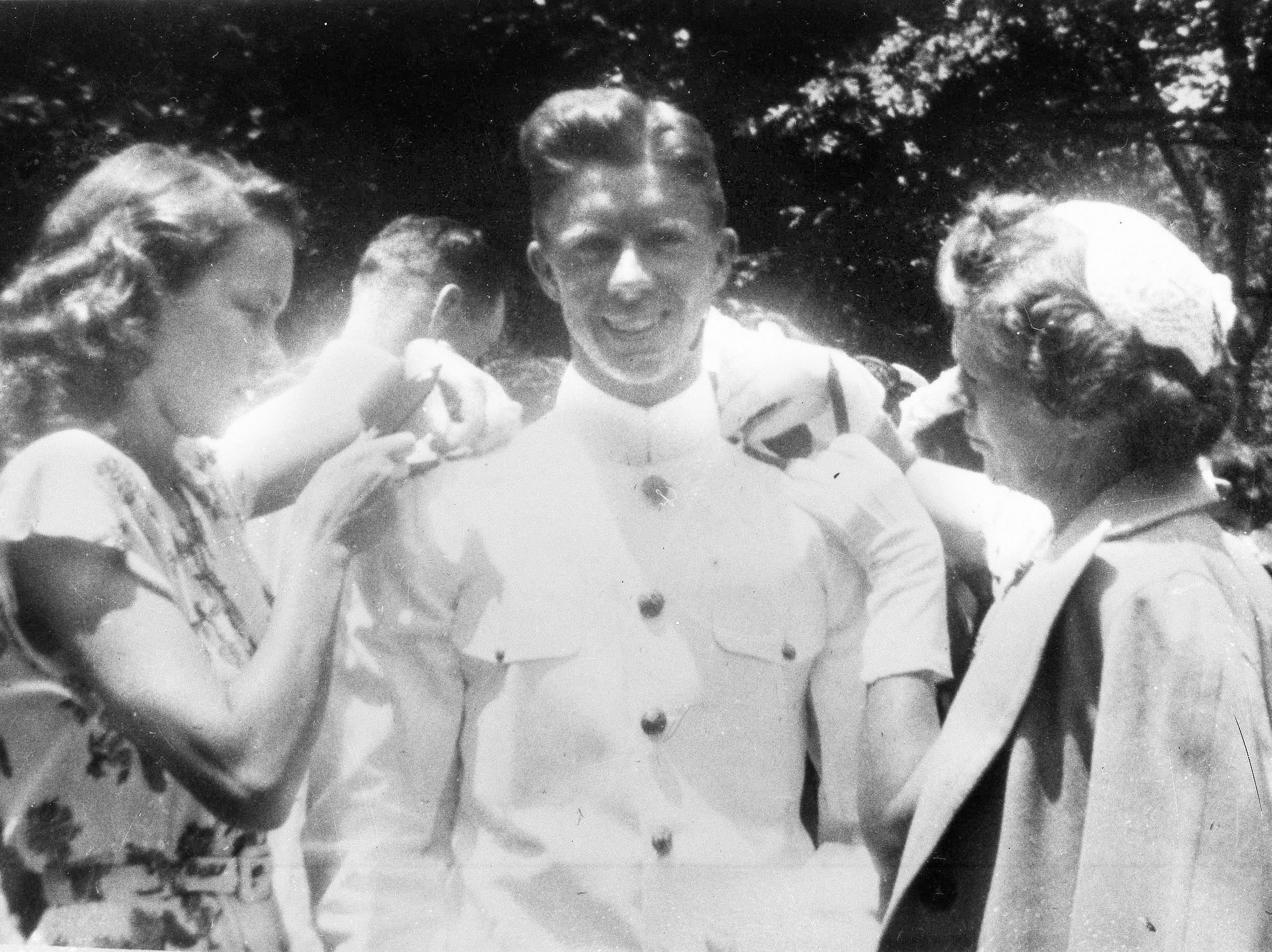 Jimmy Carter gets his bars pinned on by his wife Rosalynn, left and his mother, Mrs. Lillian Carter at the U.S. Naval Academy in this undated photo.