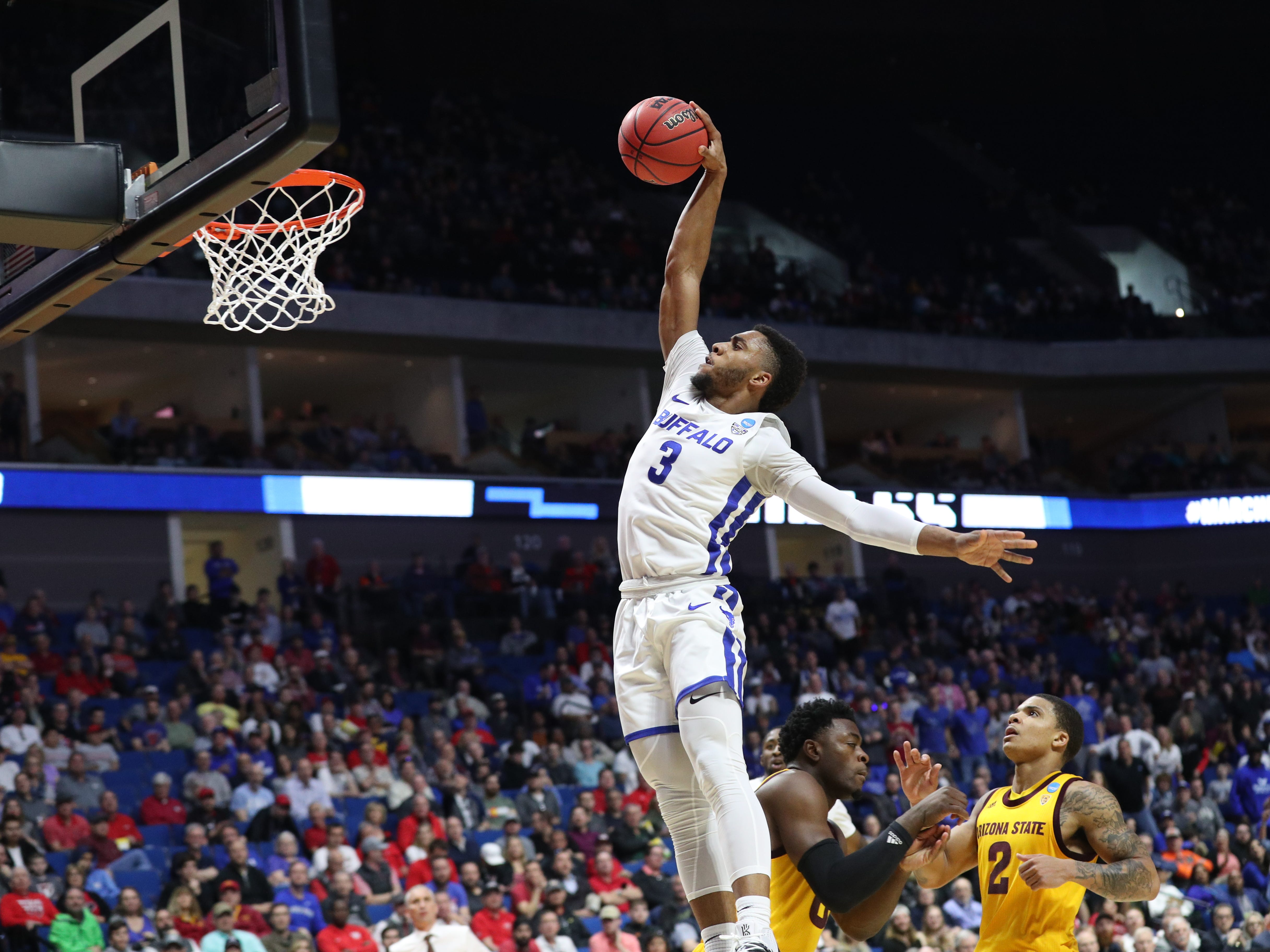 First round: Buffalo Bulls guard Jayvon Graves goes up for a dunk during his team's win over the Arizona State Sun Devils.
