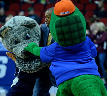 First round: TV analyst Reggie Miller pretends to break up a fight between the mascots of the Nevada Wolf Pack and the Florida Gators.