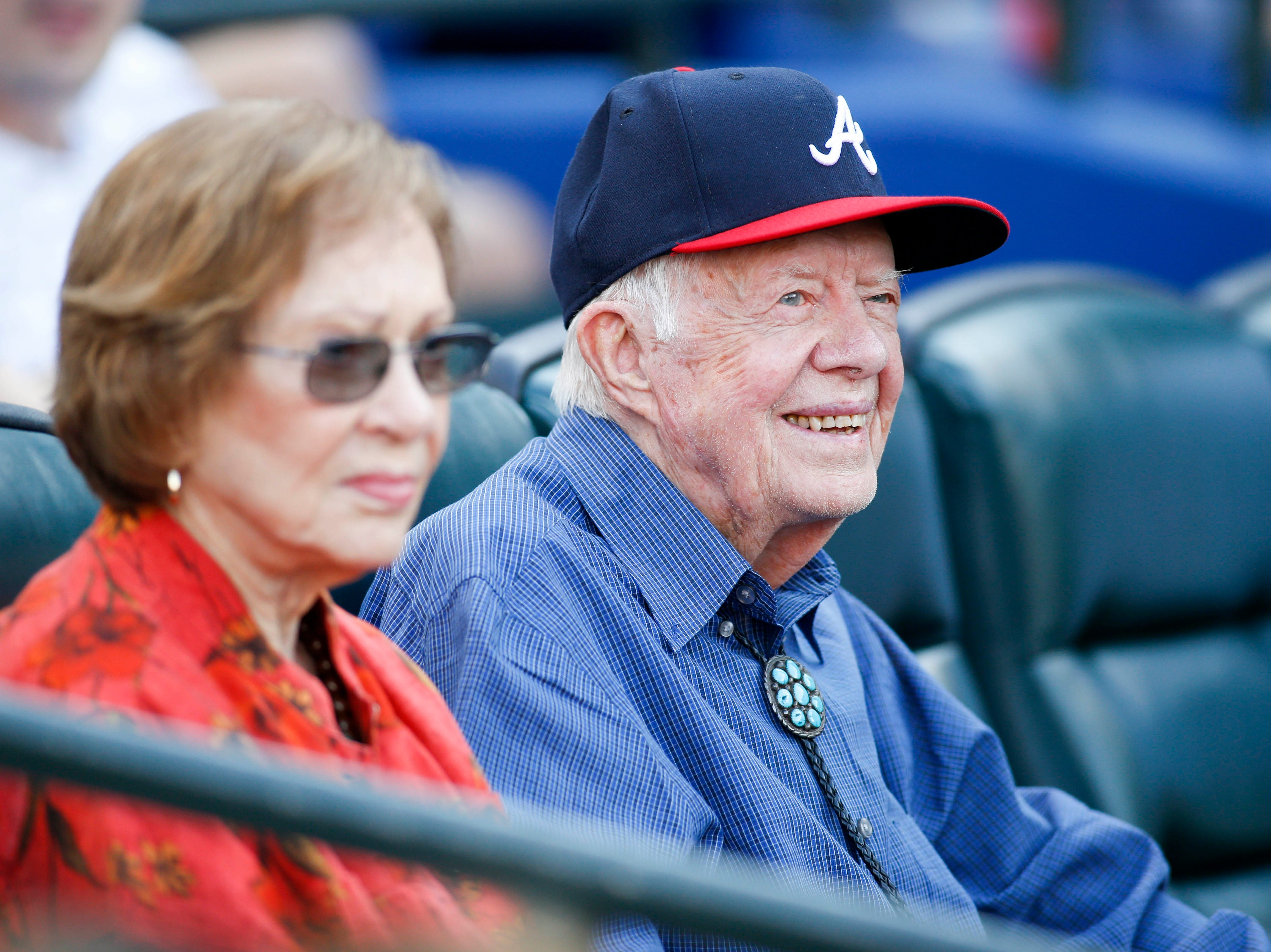 Jimmy Carter and his wife Rosalyn watch a game between the Atlanta Braves and Detroit Tigers in the eighth inning at Turner Field in Atlanta on Oct. 2, 2016.