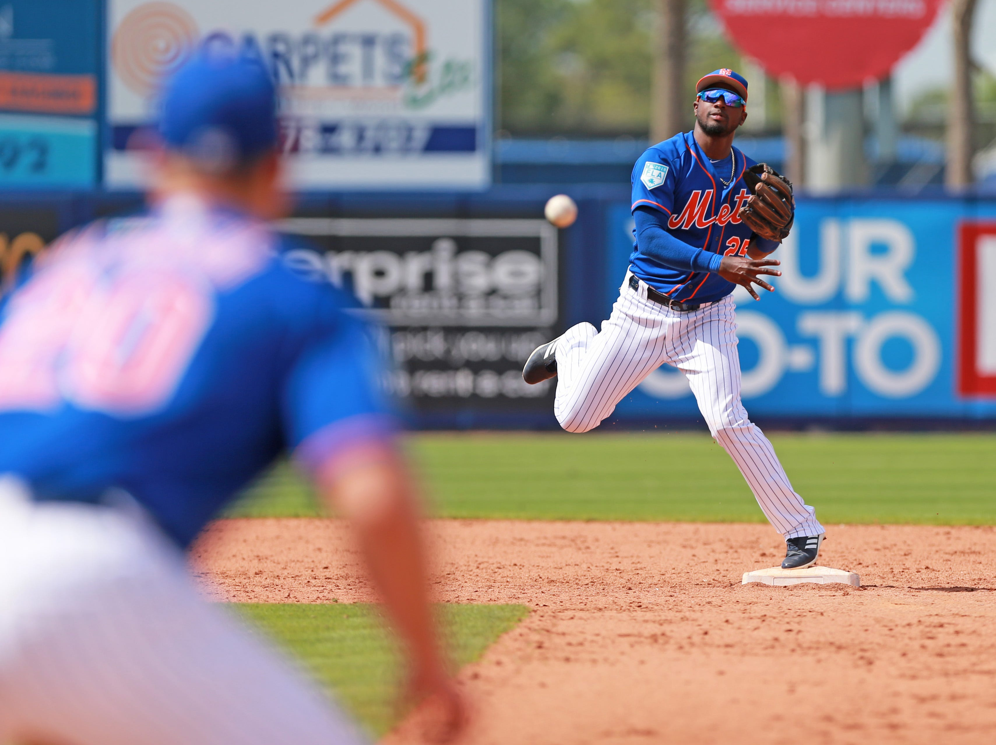 March 21: Mets shorstop Amed Rosario throws to first against the Marlins.