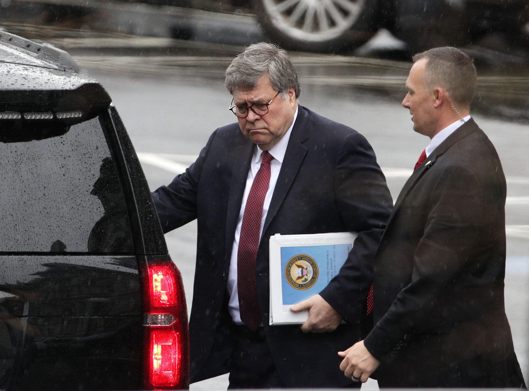 Attorney General William Barr, left, leaves after a meeting at the West Wing of the White House March 21, 2019 in Washington, DC. Key law-enforcement officials in Washington are preparing for the release of the report by special counsel Robert Mueller.