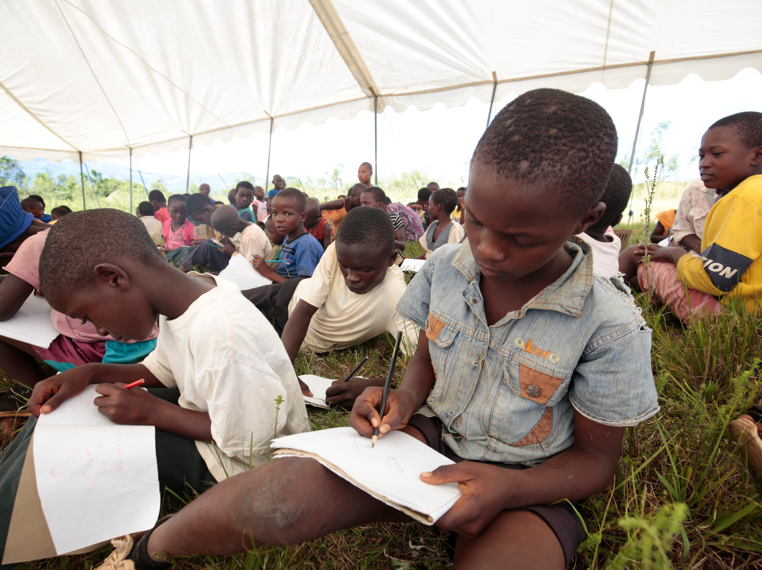 Children who have not been going to school in the aftermath of Cyclone Idai devastations, are being educated by the Regional Psychosocial Support Initiative (REPSSI), which offers  psychosocial support, technical expert, capacity builder and advocacy, in Chimanimani, Zimbabwe on March 21, 2019.