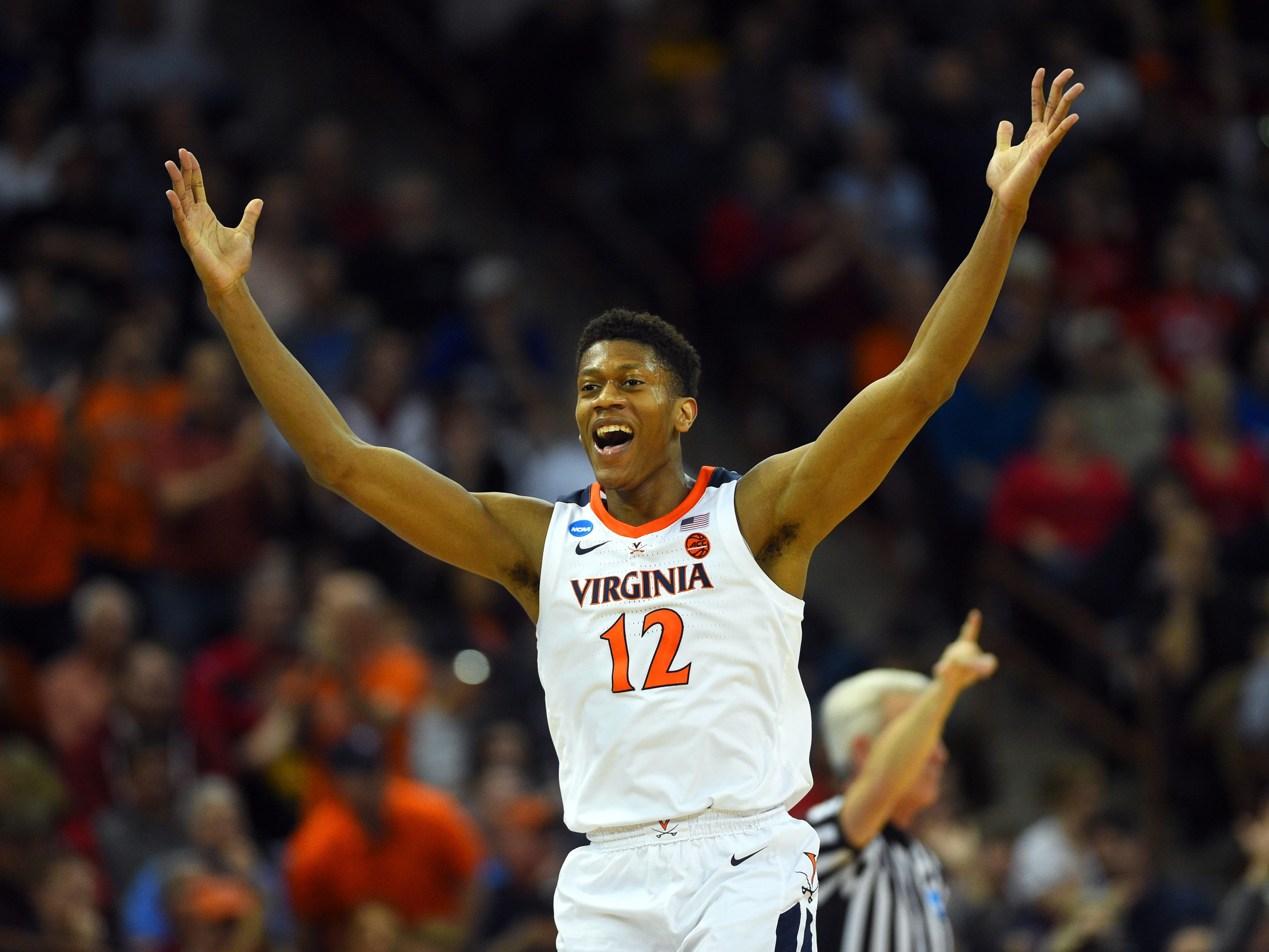 First round: No 16-over-1 upset this time! Virginia guard De'Andre Hunter celebrates after making a shot during the second half against Gardner-Webb. The Cavaliers fell behind early but went on to win, 71-56.