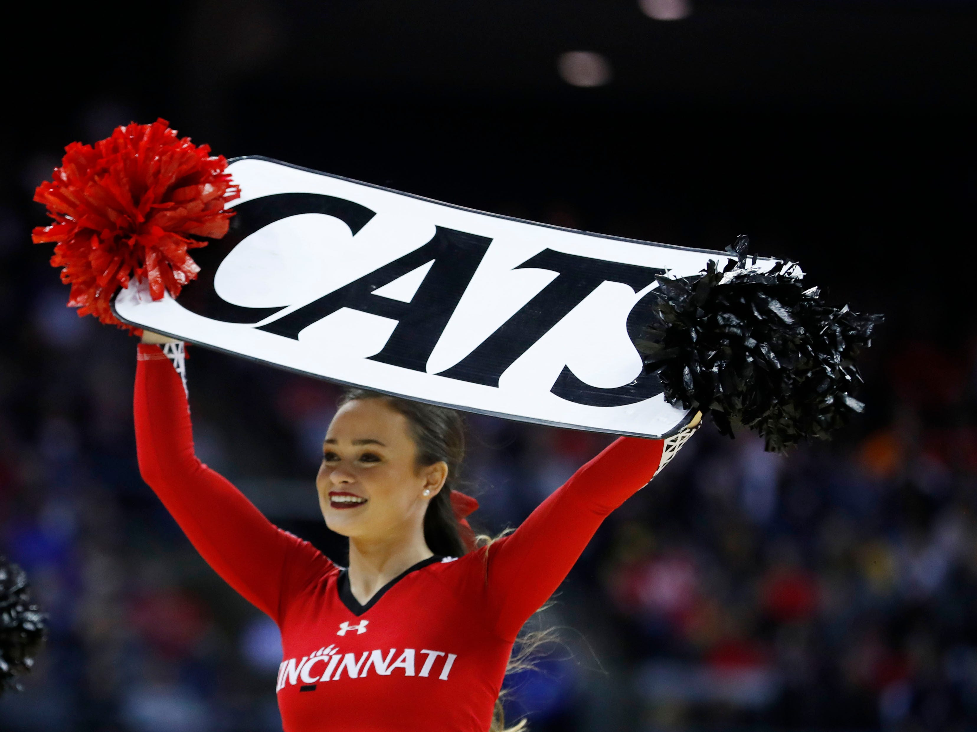 First round: A Cincinnati Bearcats cheerleader during the game against the Iowa Hawkeyes.
