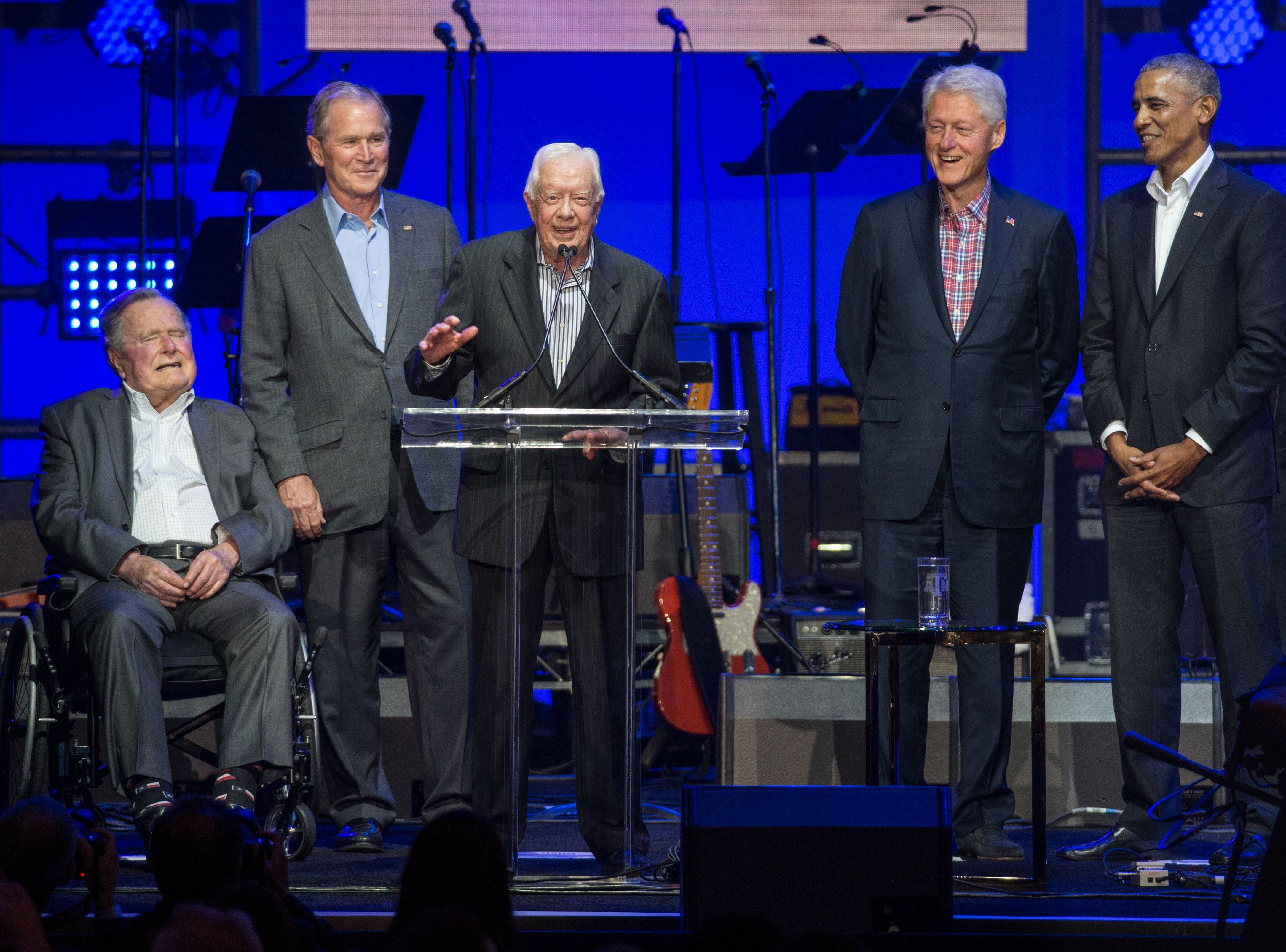 Jimmy Carter speaks along side other former presidents' George H. W. Bush, George W. Bush, Bill Clinton and Barack Obama as they attend the Hurricane Relief Concert in College Station, Texas, on Oct. 21, 2017.
