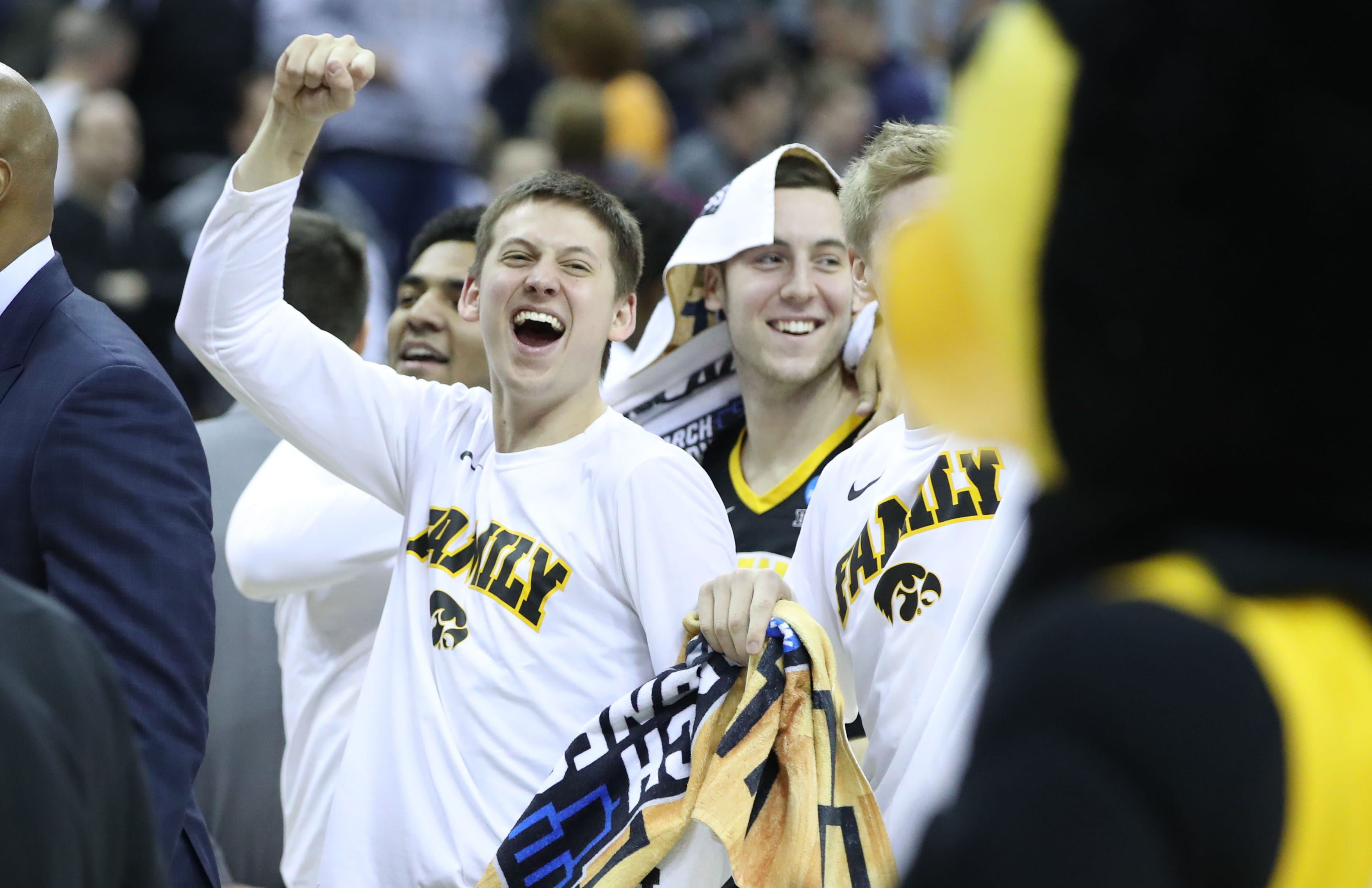 Iowa players celebrate after defeating Cincinnati in the first round of the 2019 NCAA tournament.