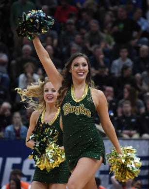 First round: Baylor cheerleaders perform during the game against Syracuse.