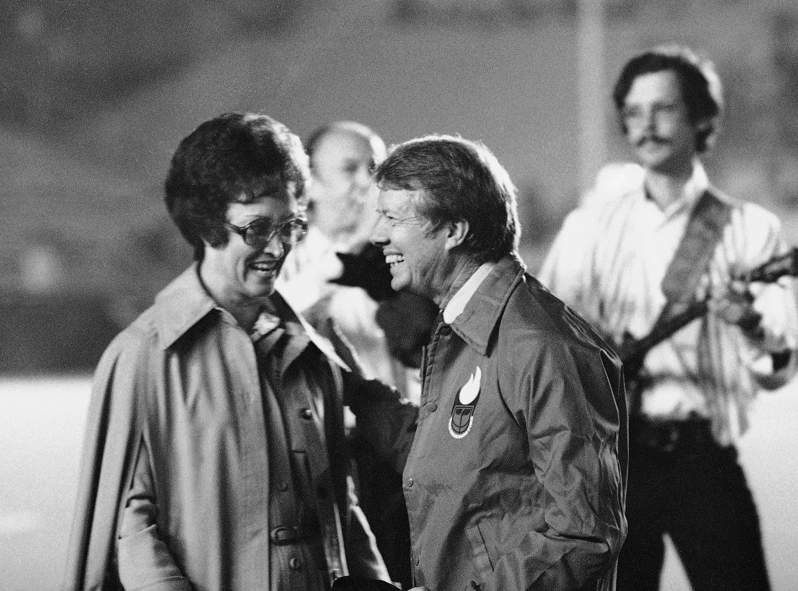 Georgia Gov. Jimmy Carter sports a Chicago Fire team jacket presented to him by Betty Spence, Democratic congressional candidate from the Illinois 12th District, in Chicago, Sept. 19, 1974.