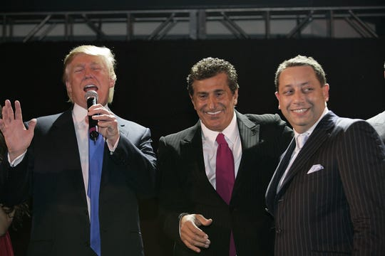 Donald Trump, Tevfik Arif and Felix Sater attend the Trump SoHo launch party on September 19, 2007 in New York.