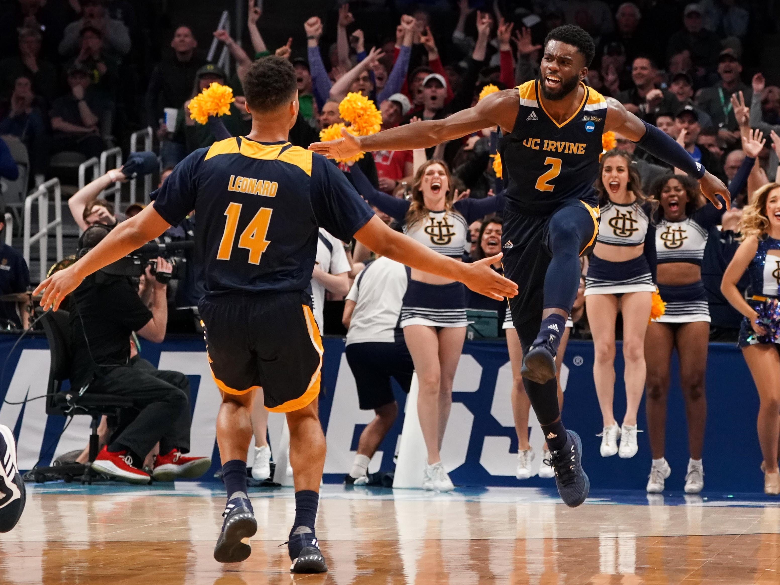 First round: UC Irvine Anteaters guards Max Hazzard and Evan Leonard celebrate during their team's upset win over Kansas State.
