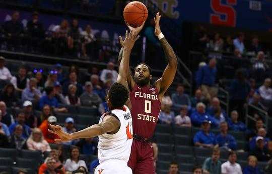 Florida State forward Phil Cofer shoots the ball against Virginia during in the 2019 ACC conference tournament.