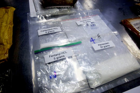 Packages containing fentanyl and carfentanil are stored in the detention room at the JFK International Airport Mail Facilities Federal Inspection Site after being discovered by U.S. Customs and Border Protection officers in this file photo.