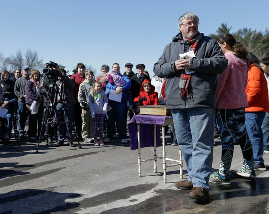 """The 150-year-old Bible sitting on the table survived two church fires. """"It's a great testament to our faith that stands strong even in the midst of this (fire),"""" said Pastor Tim O'Brien, who led a vigil outside the Springs — United Methodist Church in Plover, Wisconsin, on on Tuesday, March 19, 2019."""