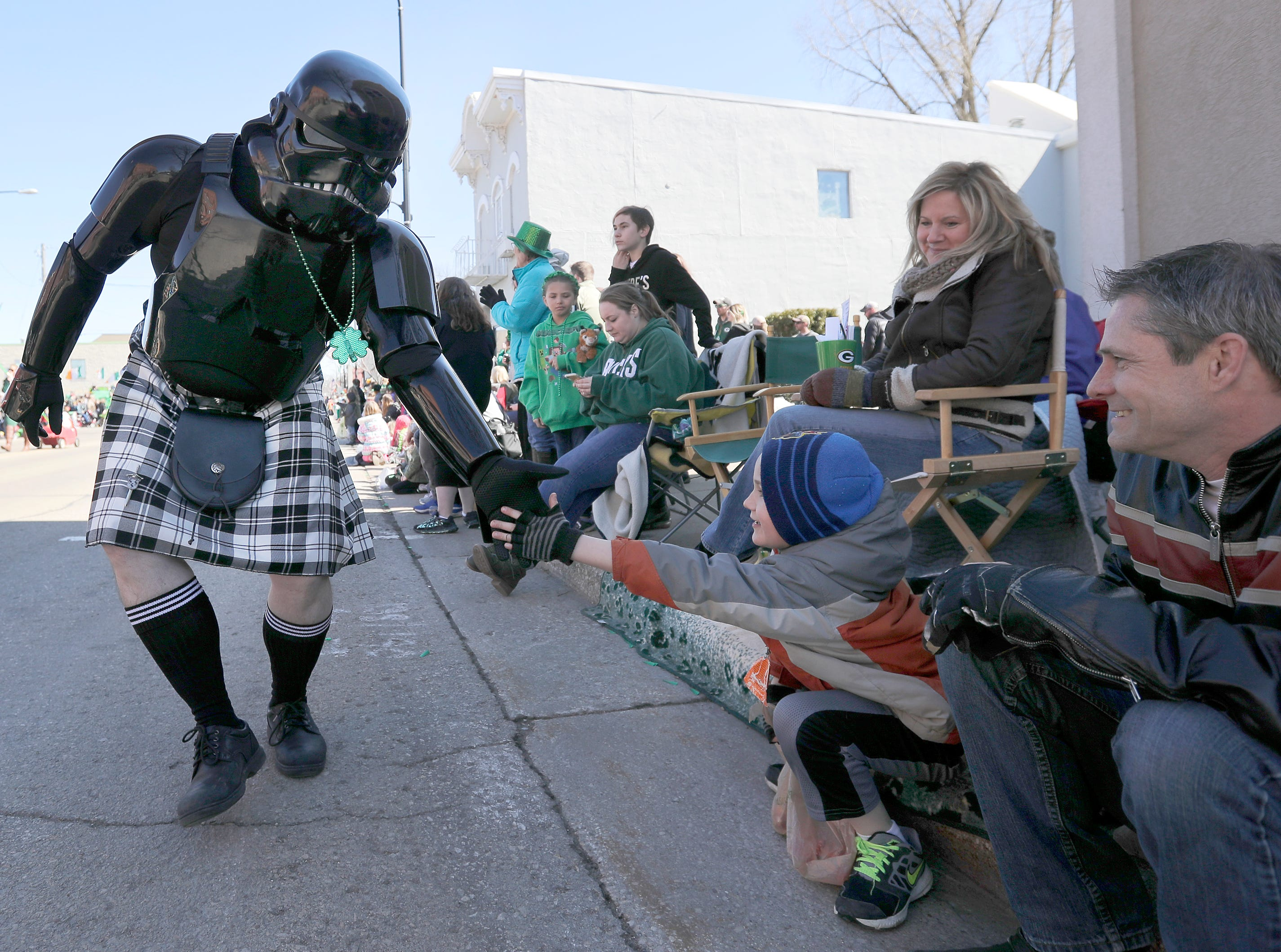 Gabe Knaus high fives a kilt clad Darth Vader during the New Dublin St. Patrick's Day Grand Parade on Saturday, March 23, 2019, in New London, Wis.Wm. Glasheen/USA TODAY NETWORK-Wisconsin.