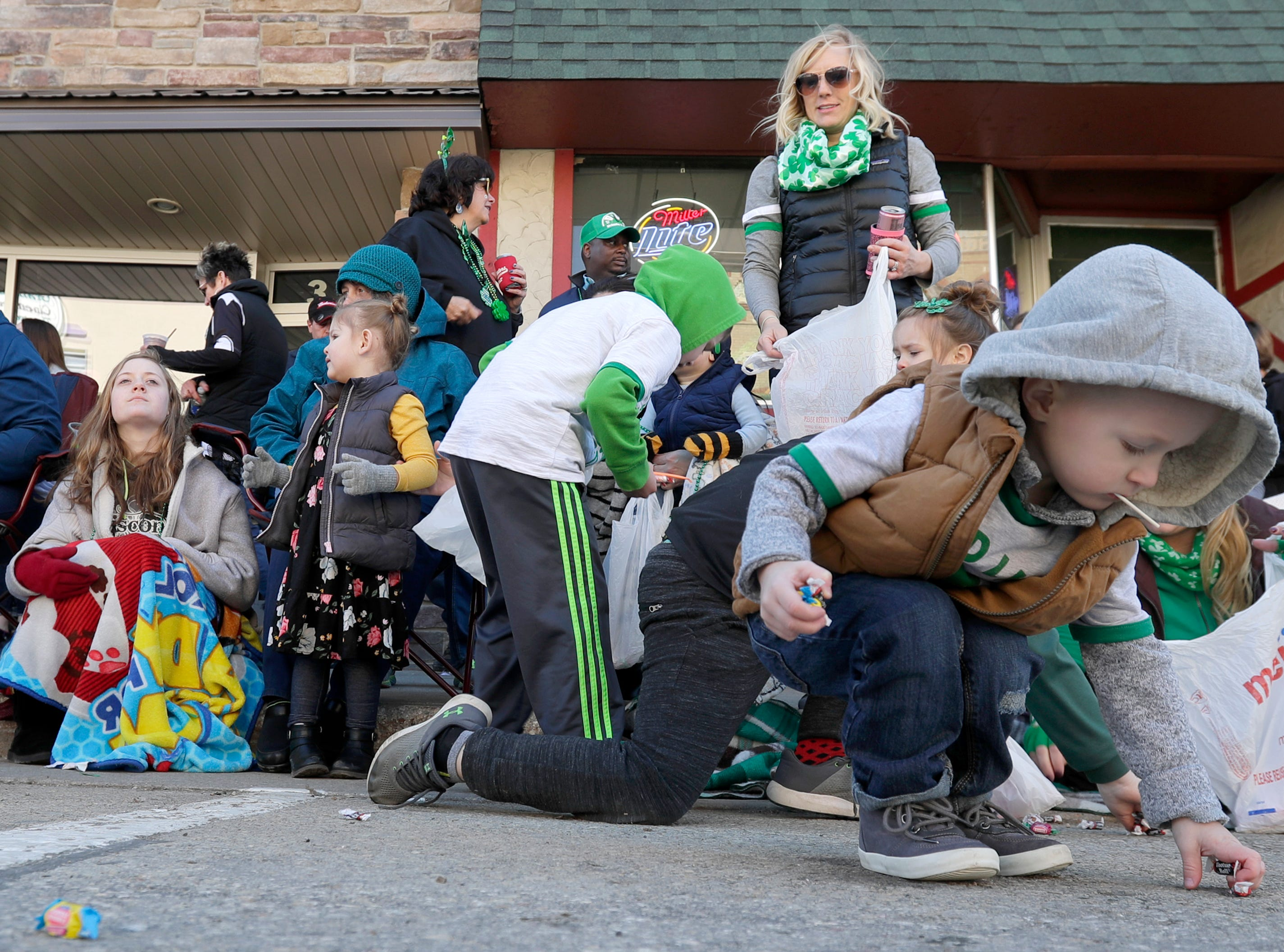 Mason Olinger collects candy during the New Dublin St. Patrick's Day Grand Parade on Saturday, March 23, 2019, in New London, Wis.Wm. Glasheen/USA TODAY NETWORK-Wisconsin.