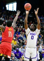 LSU Tigers forward Naz Reid (0) shoots while defended by Maryland Terrapins guard Darryl Morsell (11) during the first half in the second round of the 2019 NCAA Tournament at Jacksonville Veterans Memorial Arena.
