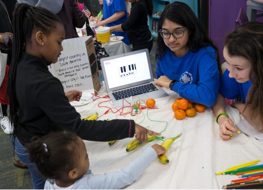 Aarya Doshi, 14, a student of High Tech High School, volunteers with SteamPark to help teach children throughout Monmouth County. As part of NJ Maker's Day, the Neptune Library offers Travel the World with STEAM Activities Fair for children to learn about sciences and technology.    