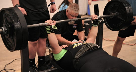 Snyder's Kobe Fahntrapp competes in the bench press at the Texas High School Powerlifting Association state meet Saturday, March 23, 2019, at the Taylor County Expo Center. He won the Division II 275-pound weight class for his first state title.