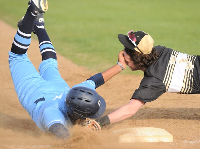 Abilene High third baseman Ethan Flanders, right, tags out Bell runner Mitchel Ornelas, who was trying to steal third base in the seventh inning. He was cut down on the throw by catcher Matthew Ezzell. The Blue Raiders beat AHS 4-3 in the District 3-6A game Friday, March 22, 2019, at Blackburn Field.