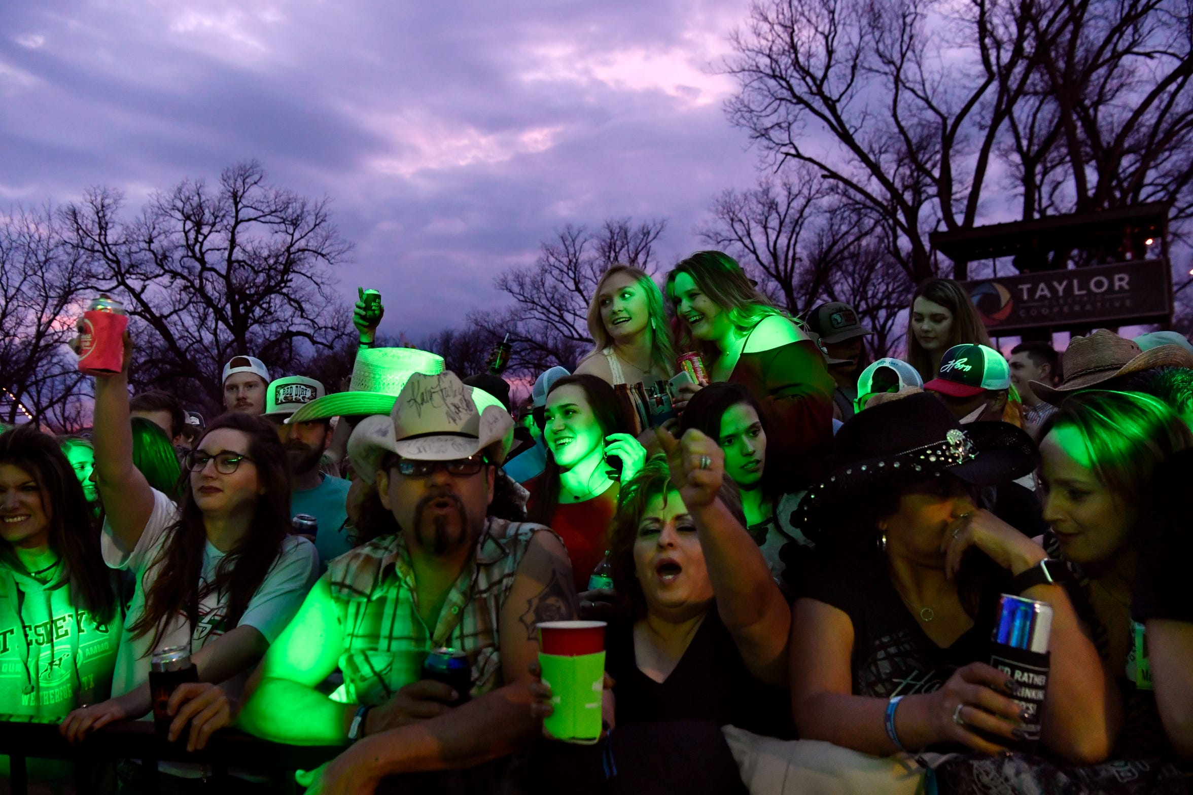 Fans listen and cheer Roger Creager during his performance at the Back Porch of Texas at the 2019 Outlaws & Legends Music Festival.