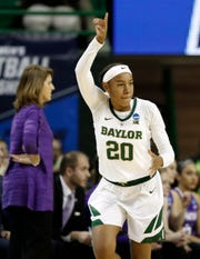 Baylor guard Juicy Landrum (20) celebrates sinking a 3-point basket in the first half of a first-round game against Abilene Christian in the NCAA women's college basketball tournament in Waco, Texas, Saturday March 23, 2019.(AP Photo/Tony Gutierrez)