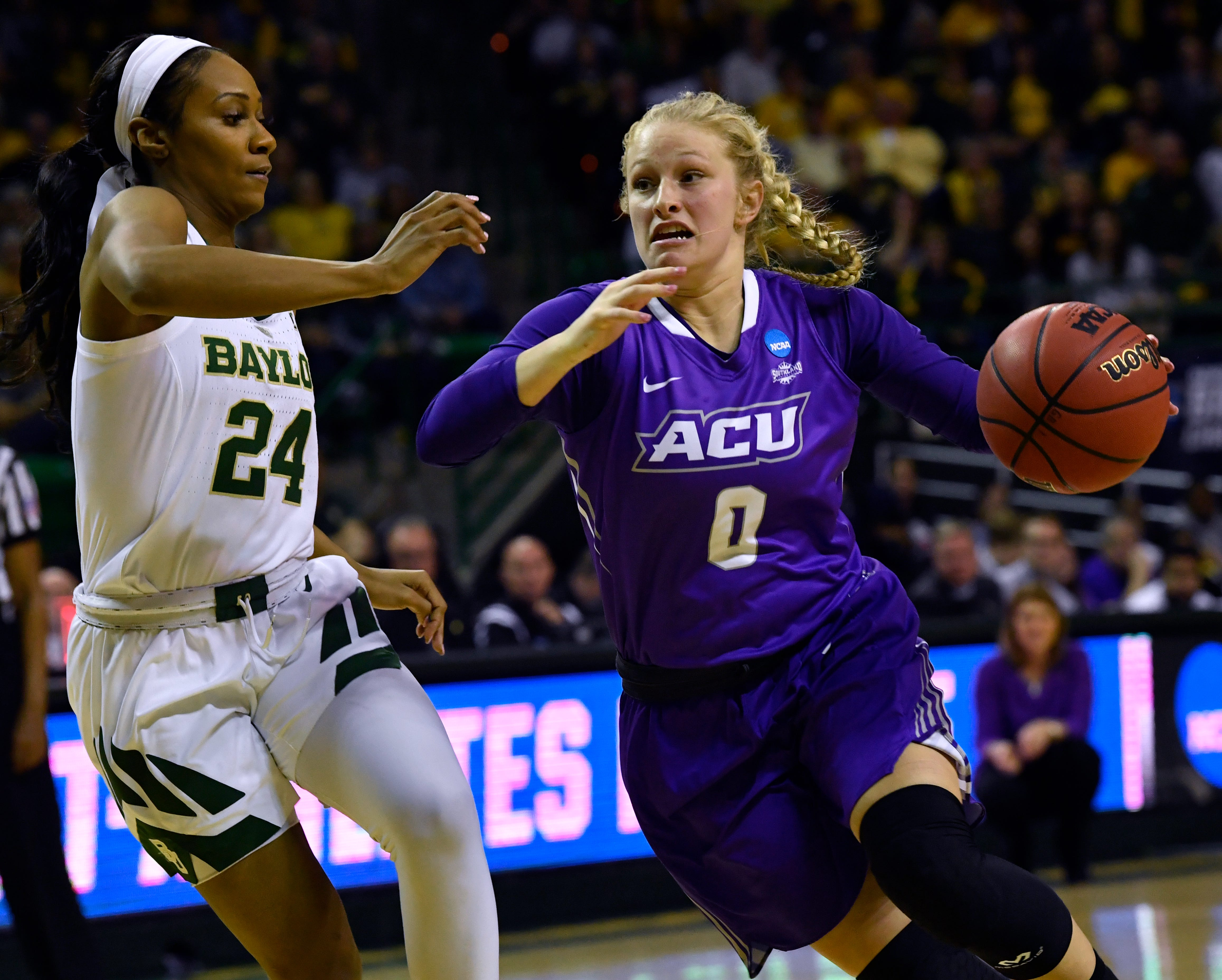 ACU's Kamryn Mraz drives past Baylor's Chloe Jackson during Round 1 of Saturday's NCAA Div. 1 women's basketball in Waco.