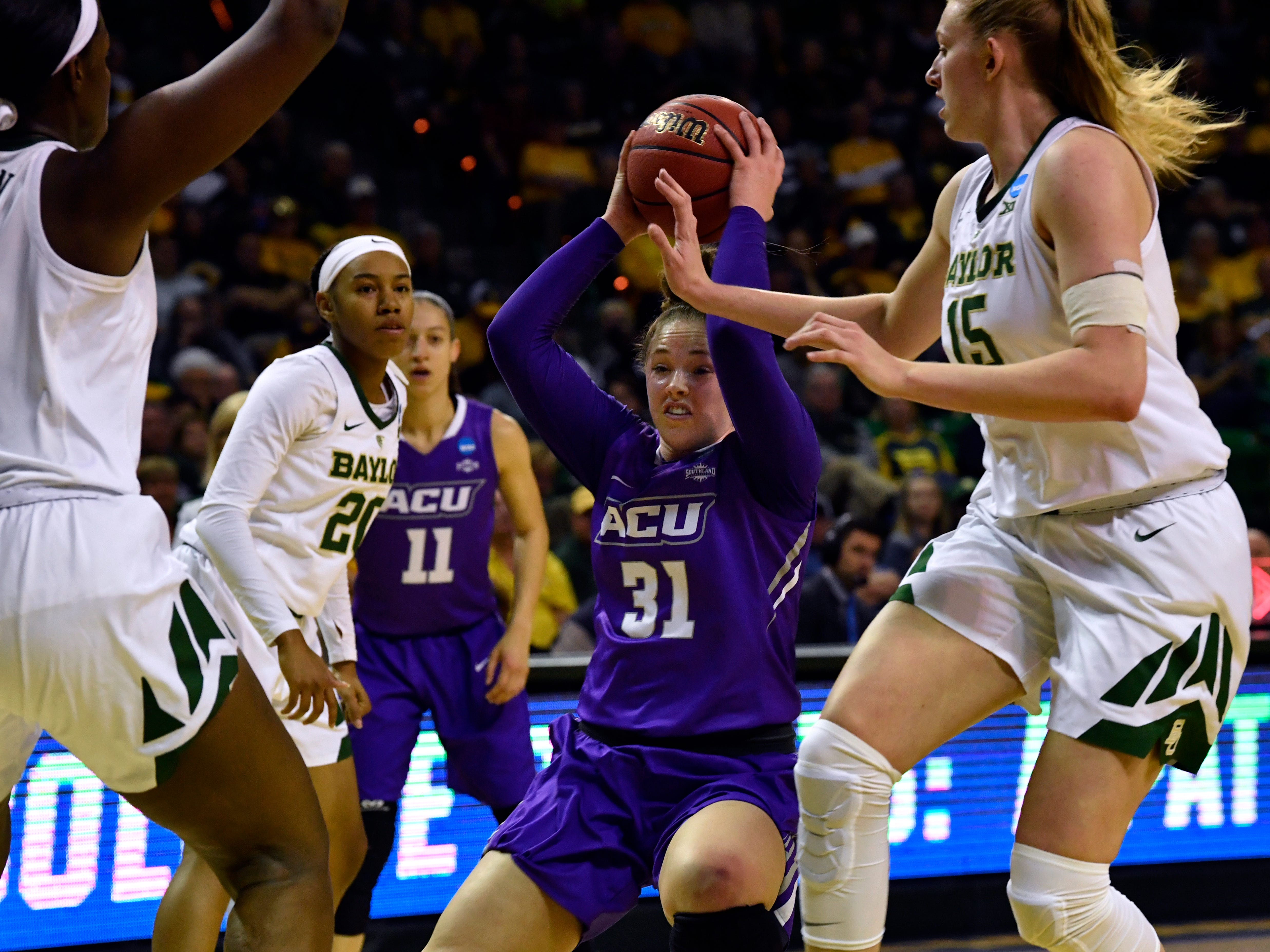 ACU's Madi Miller is surrounded by Baylor Bears during Saturday's NCAA women's Tournament game in Waco March 23, 2019.