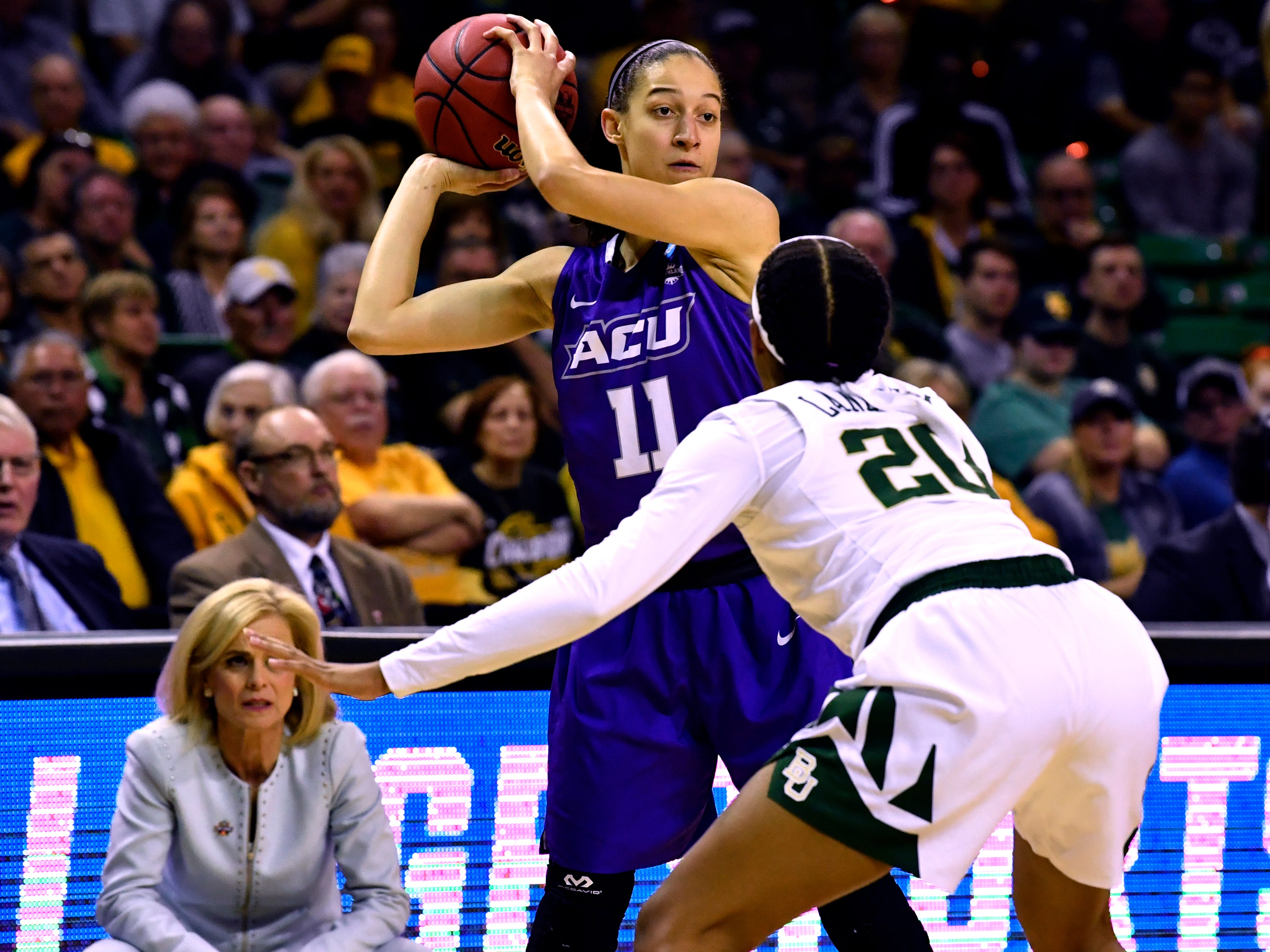 ACU's Sara Williamson looks for an opening past Baylor's Juicy Landrum during Saturday's NCAA Tournament women's round 1 basketball game March 23, 2019.