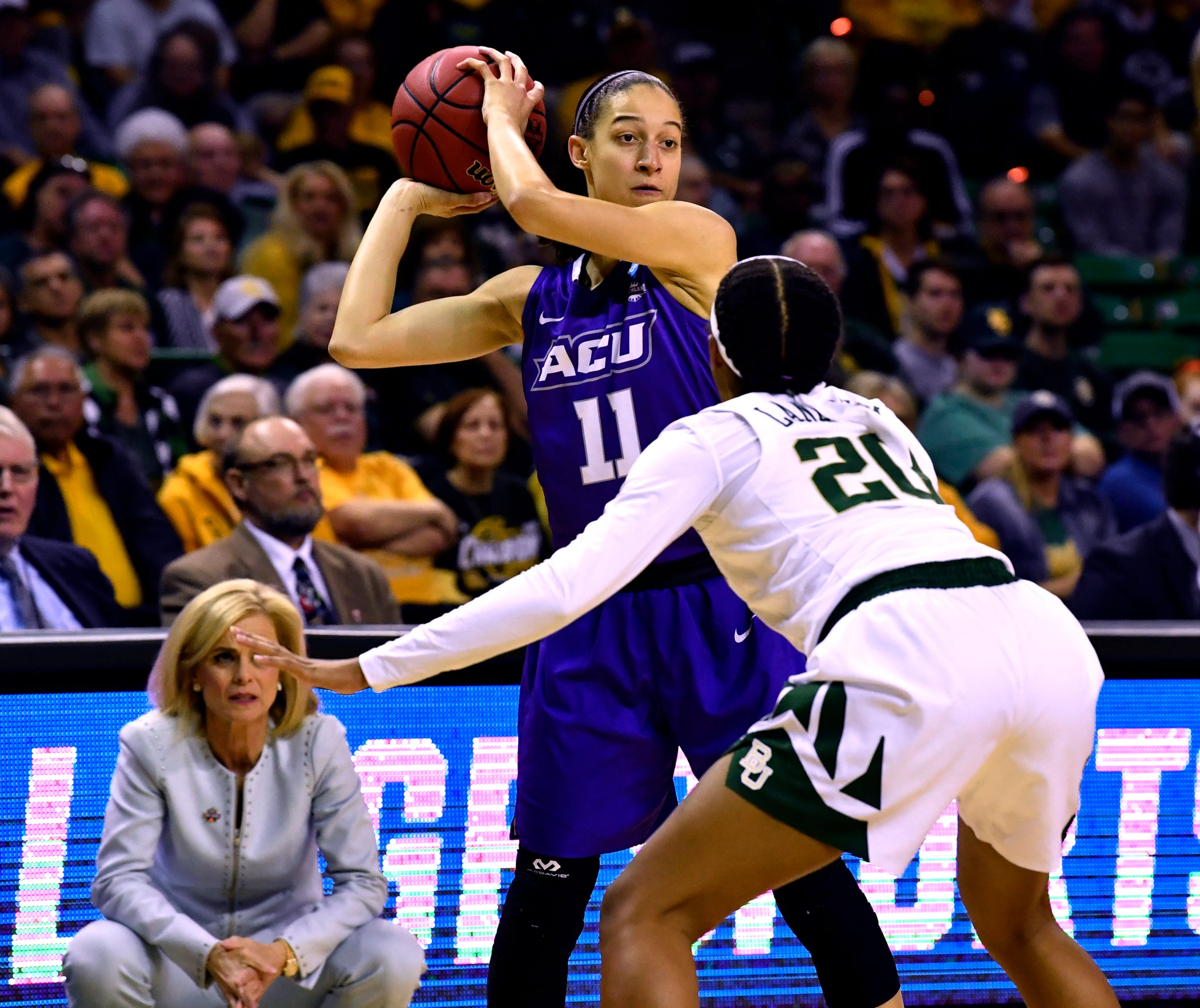 ACU's Sara Williamson looks for an opening past Baylor's Juicy Landrum during the first round of the NCAA Tournament. The Wildcats won the Southland Conference tournament to make it to the Division I tournament for the first time in school history in their first year of eligibility. Baylor would go on to win the national championship.