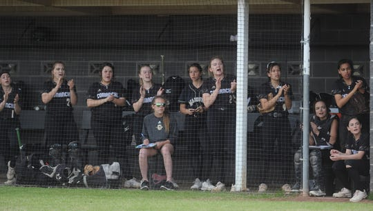 Players in the Comanche dugout cheer during an at-bat against Eastland in a District 6-3A softball game Friday, March 22, 2019, in Eastland.