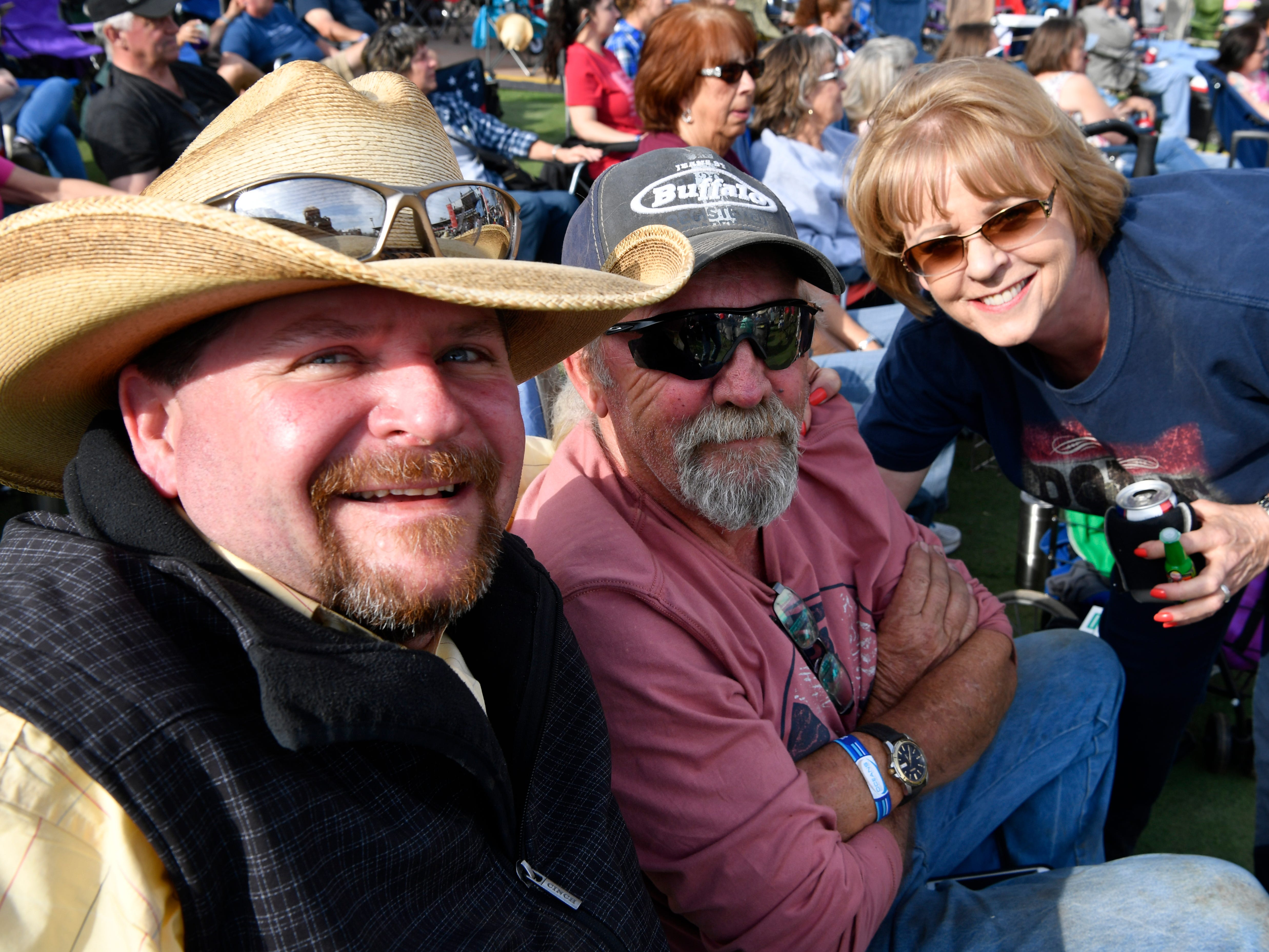 Jeff Yates (left), Altus Stark, and Sharon Wilkinson wait for the next act during Friday's Outlaws & Legends Music Festival March 22, 2019.