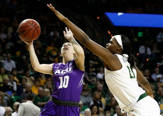 Abilene Christian guard Breanna Wright (10) works for a shot against Baylor's Kalani Brown (21) in the first half of a first-round game in the NCAA women's college basketball tournament in Waco, Texas, Saturday March 23, 2019.(AP Photo/Tony Gutierrez)