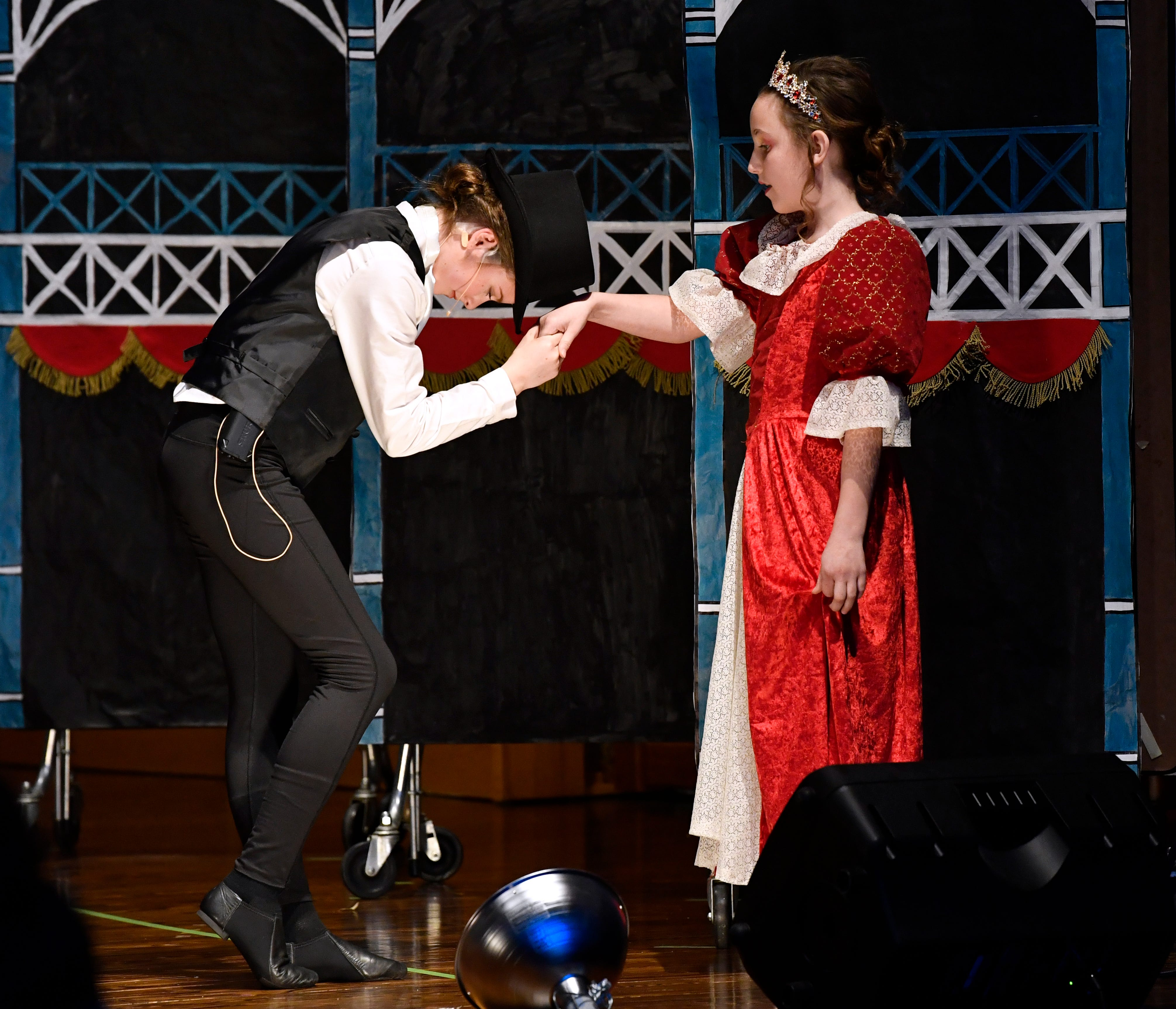 """Claire Trammell plays P.T. Barnum in a scene where he meets Queen Victoria, played by Margo Reed, in the St. John's Episcopal School's production of """"The Greatest Showman"""" on Friday."""