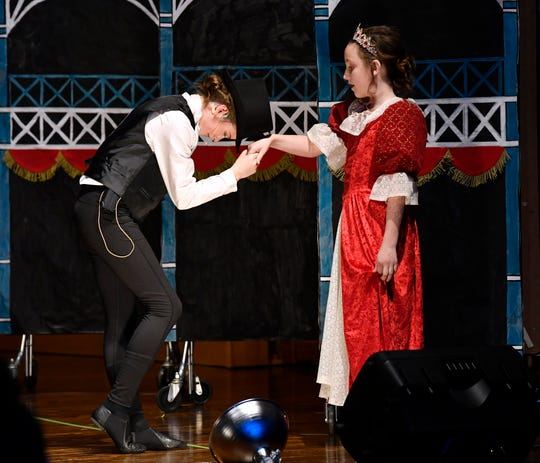 "Claire Trammell plays P.T. Barnum in a scene where he meets Queen Victoria, played by Margo Reed, in the St. John's Episcopal School's production of ""The Greatest Showman"" on Friday."