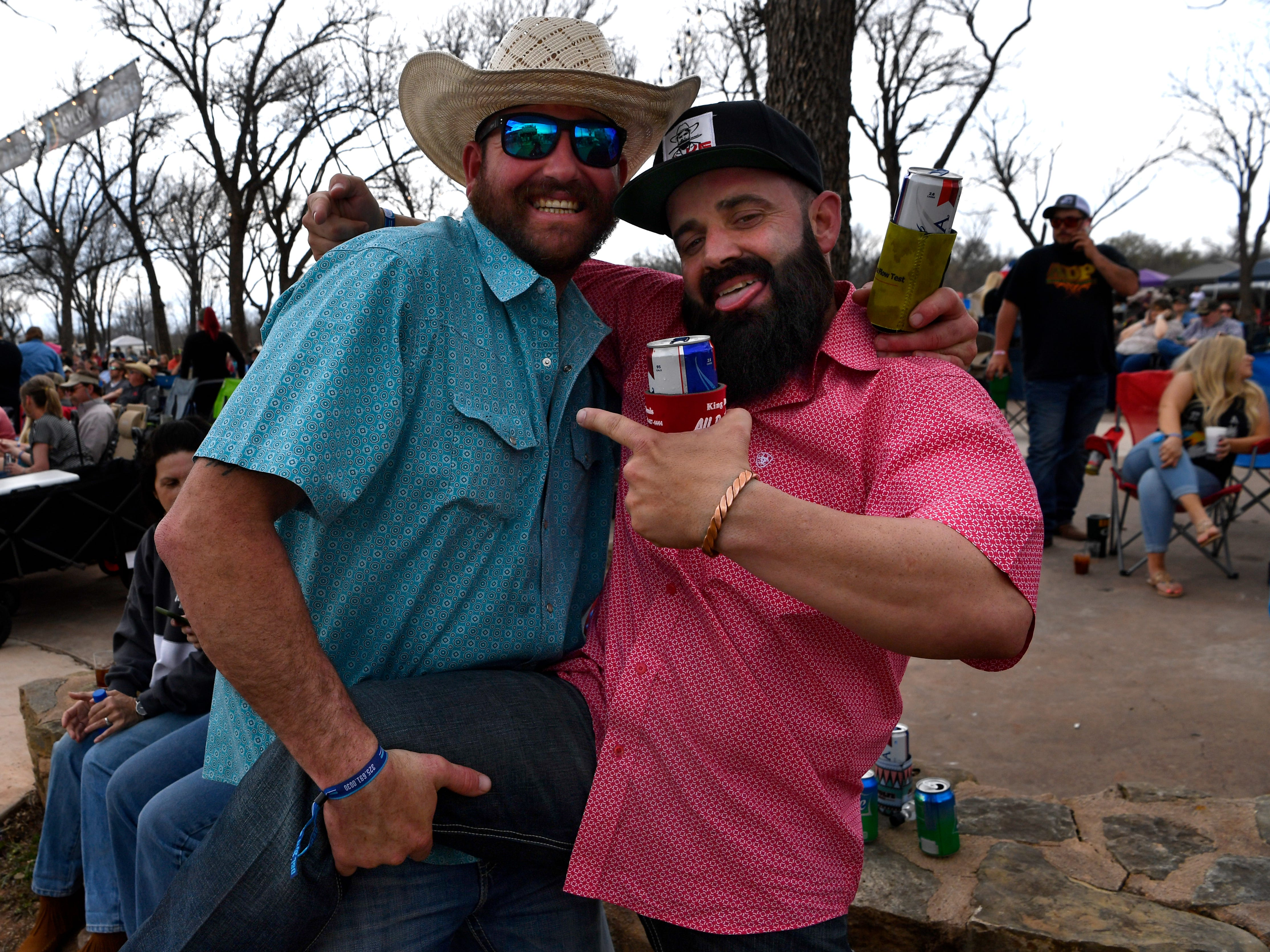 Ronnie Barnes (left) and Jimmy Isaacs both said this was their second year attending the Outlaws & Legends Music Festival Friday March 22, 2019.