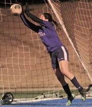 Hurst Bell goalie Johana Flores makes a stop on Lydia Sanchez's penalty kick, preserving a 4-4 tie in the shootout against Abilene High. Bell beat the Lady Eagles 5-4 in a shootout, after the team's played to a scoreless tie in regulation in the District 3-6A game Friday, March 22, 2019, at Shotwell Stadium.