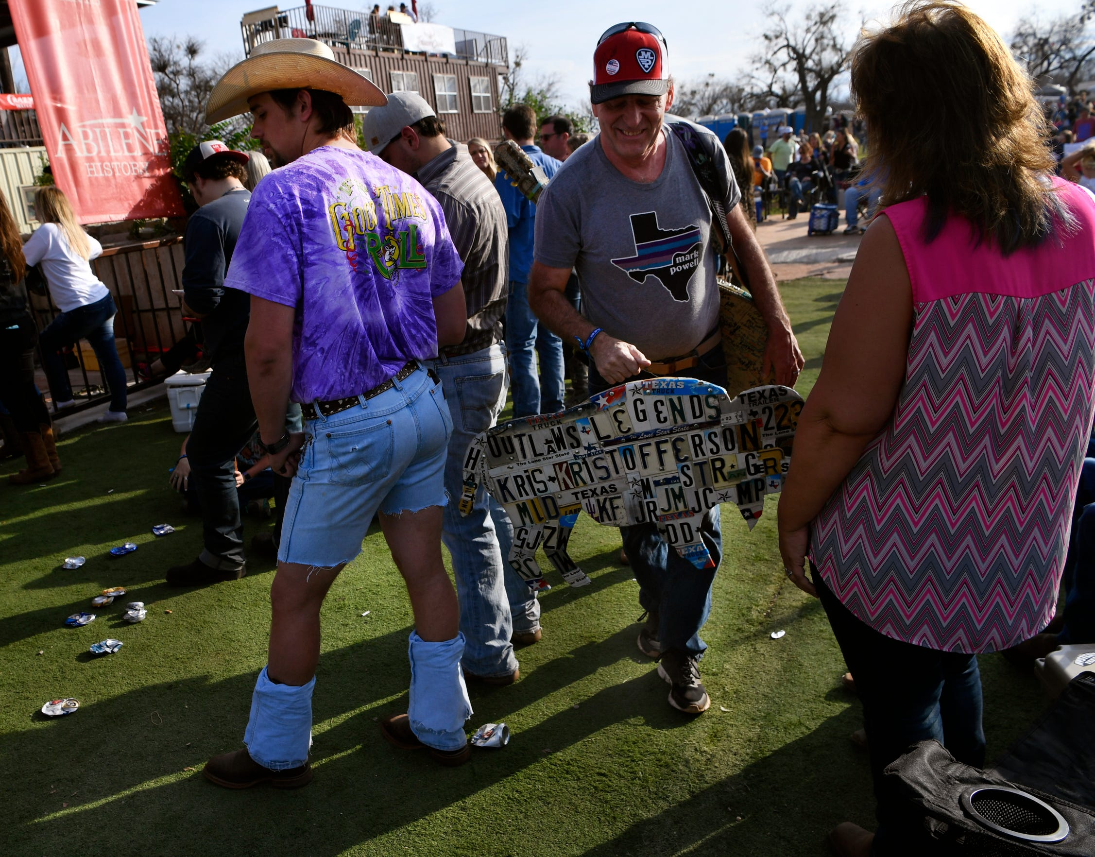 Dennis Gross carries his custom artwork made for the festival made through the crowd at the Outlaws & Legends music festival in 2019. Gross cut a buffalo shape in wood and then used old license plates to spell the names of this year's performers.