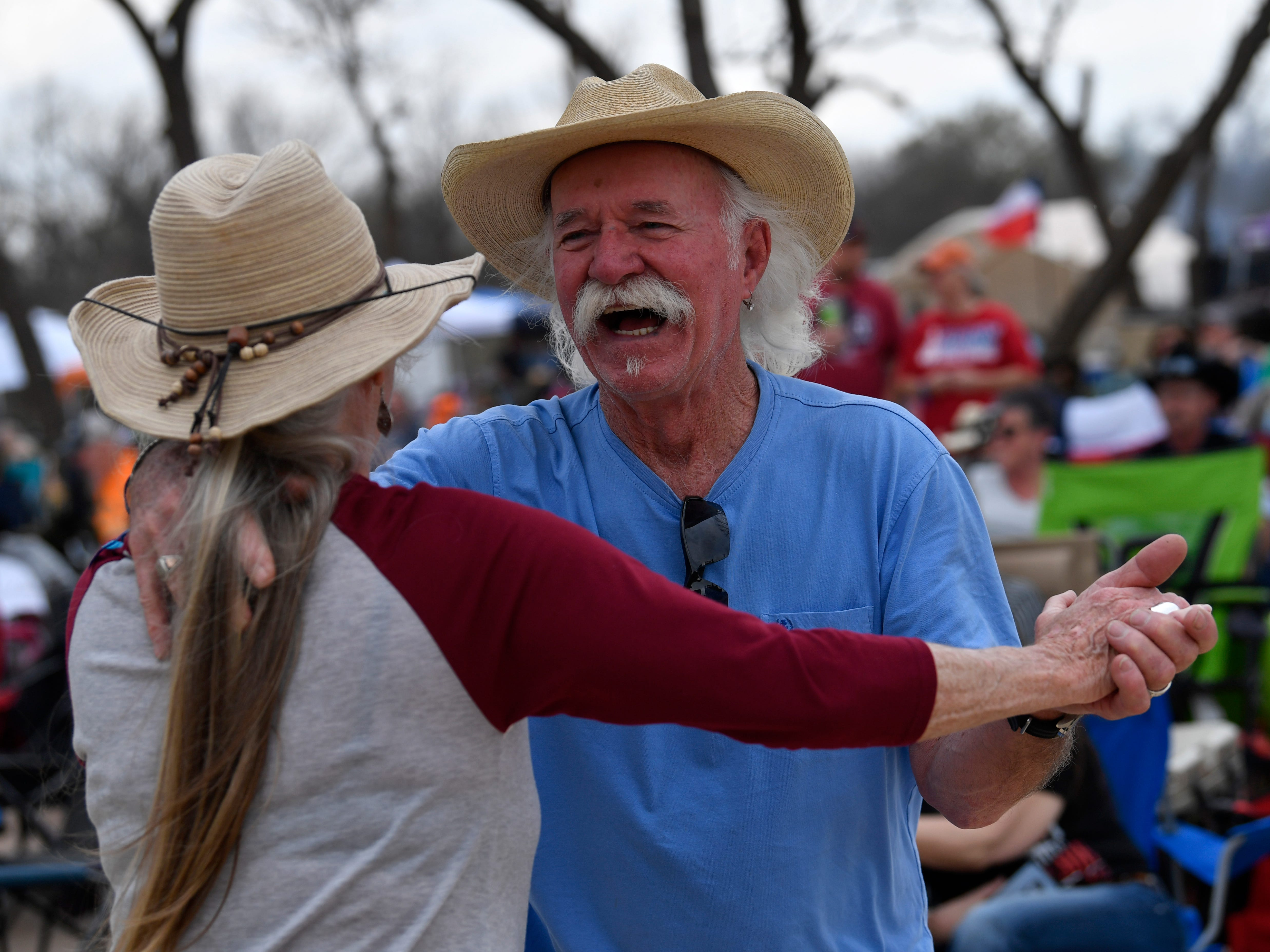 Bill Grisham dances with his wife Treva during Friday's Outlaws & Legends music festival March 22, 2019.