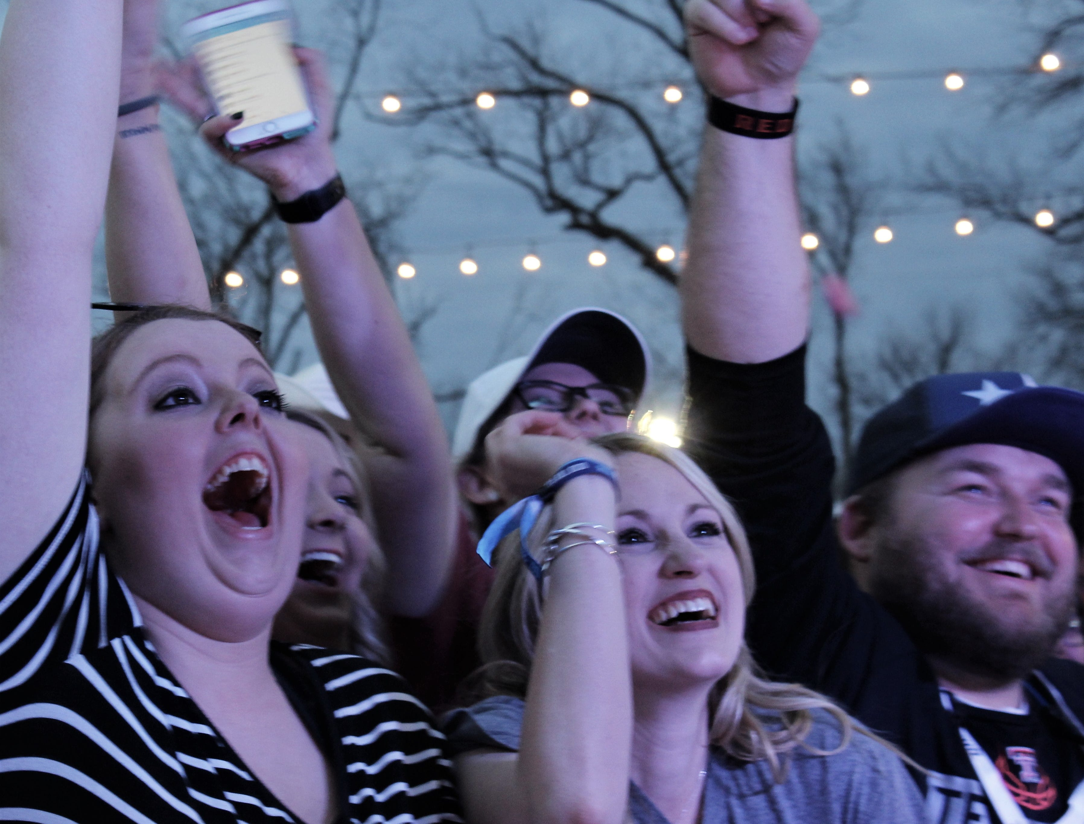 Outlaws & Legends Music Festival fans waves hands, beers and cellphones Friday evening for Roger Creager on March 22, 2019.