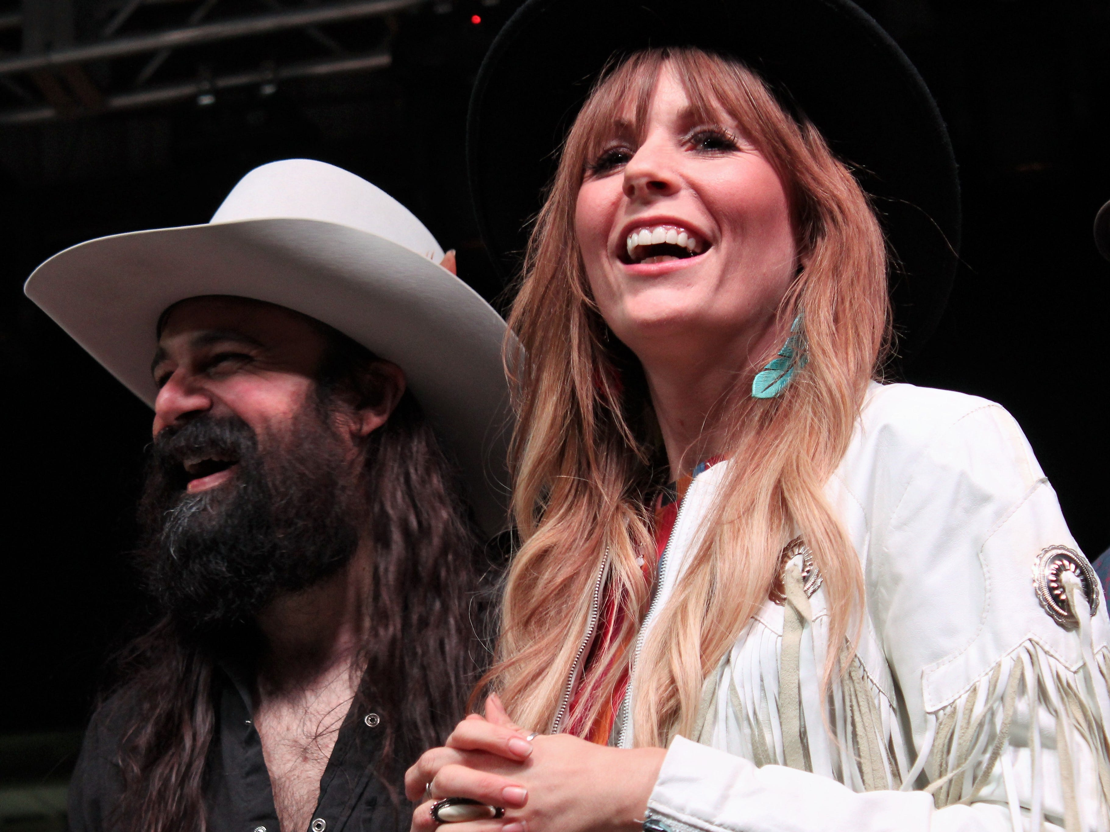 Phil Hamiton and Erica Perry laugh during Friday evening introduction of Midland. The Hamiltons were scheduled to perform Saturday March 23, 2019, at the Outlaws & Legends Musical Festival at the Back Porch of Texas.