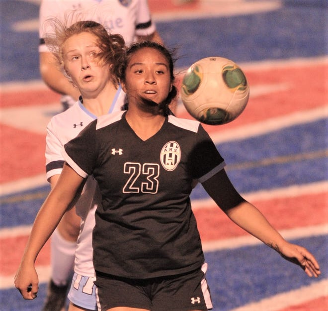Abilene High's Gabby Valero (23) battles Hurst Bell's Rylie Theodore for a ball in the first half. Bell beat the Lady Eagles 5-4 in a shootout, after the team's played to a scoreless tie in regulation in the District 3-6A game Friday, March 22, 2019, at Shotwell Stadium.