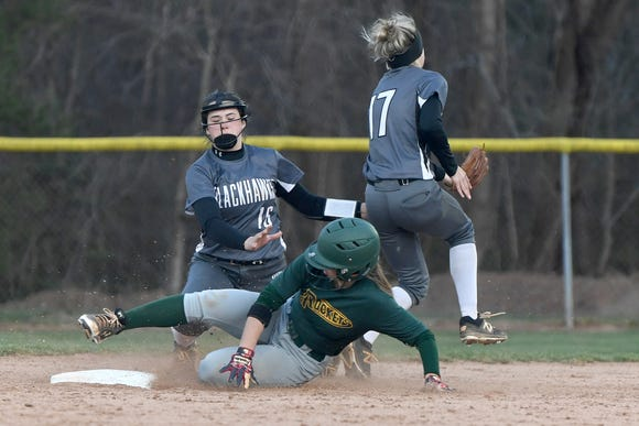 Reynolds' Lauren Wright slides safely into second base ahead of North Buncombe's Caitlin Griffin during their game at Reynolds High School on March 22, 2019. North Buncombe defeated Reynolds 15-0.