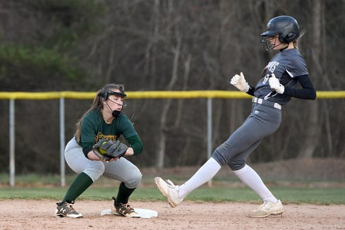 North Buncombe's Karlyn Pickins lands safely on second base against Reynolds' Lauren Wright during their game at Reynolds High School on March 22, 2019. North Buncombe defeated Reynolds 15-0.