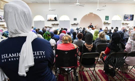 Hundreds of people representing many different religious and civic organizations fill the Islamic Society of Brevard mosque in Melbourne March 23. They gathered in remembrance of the victims of the March 15 massacre in New Zealand and to show their solidarity with Muslims living locally.
