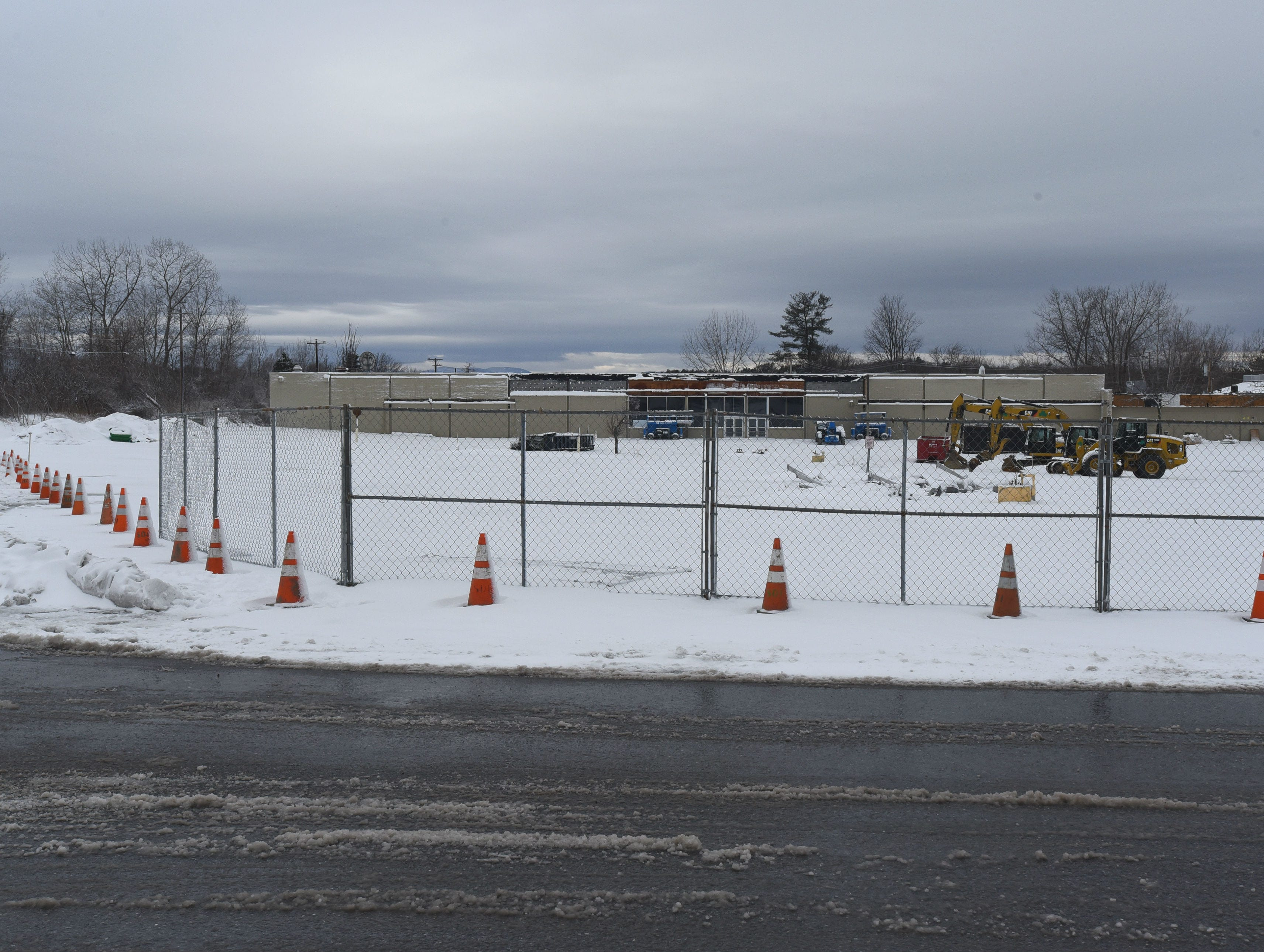 The parking lot of the former Kmart shopping center on Shelburne Road in South Burlington is fenced off on Saturday, March 23, 2019, as renovation work gets underway.