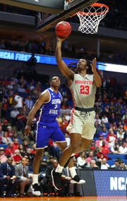 Mar 22, 2019; Tulsa, OK, USA; Houston Cougars forward Cedrick Alley Jr. (23) shoots against Georgia State Panthers forward Malik Benlevi (2) during the second half in the first round of the 2019 NCAA Tournament at BOK Center. Mandatory Credit: Mark J. Rebilas-USA TODAY Sports