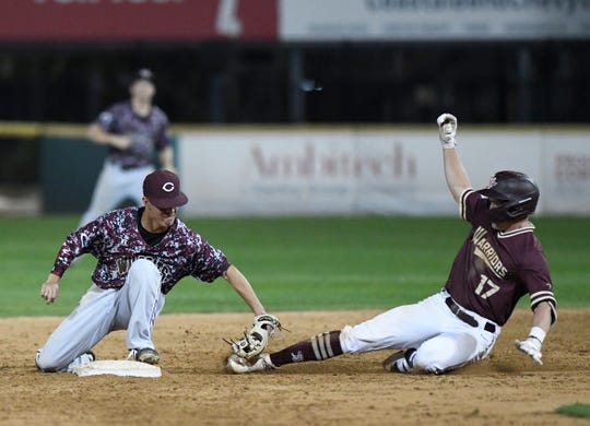 Calallen's Zach Almendarez tags Tuloso-Midway's Ben Hovda out at second base in a District 29-5A baseball game, Friday, March 22, 2019, at Whataburger Field.